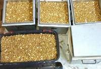 Fake gold nuggets in metal boxes
